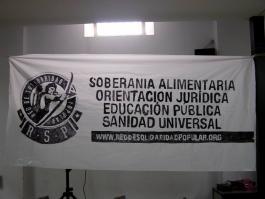 Pancarta, en la Parroquia San Carlos Borromeo, con los cuatro ejes de la RSP
